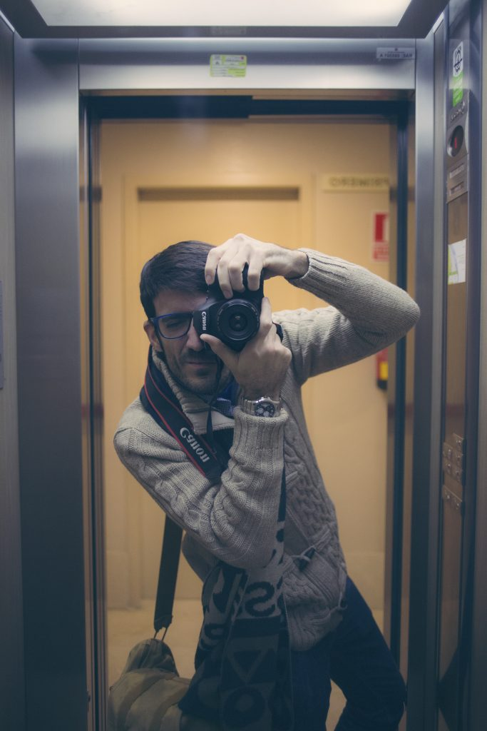 selfportrait photographer into elevator